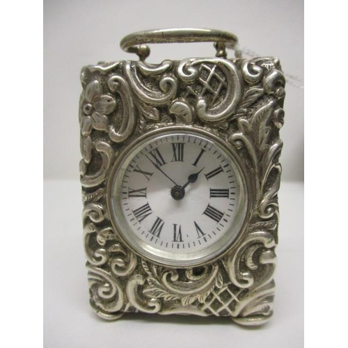 10 - A Victorian miniature, silver cased carriage clock, having a white enamelled dial with Roman numeral...