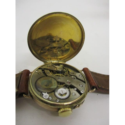 17 - An early 20th century 9ct gold cased trench watch, having a white enamelled dial, Arabic numerals, s...