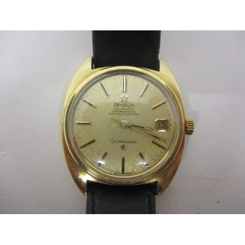 19 - An Omega constellation chronometer gents automatic, gold plated wristwatch, having a gilt baton dial...