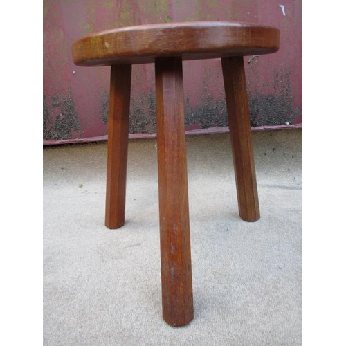 216 - A Robert Thompson Mouseman carved oak stool with a kidney shaped, dished top, raised on octagonal, t...