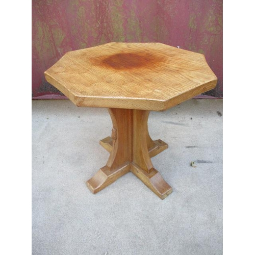 217 - A Robert Thompson Mouseman  oak occasional table with an octagonal carved honeycomb top, over a cros...