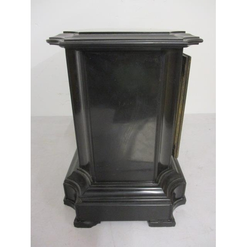 45 - A late 19th century black marble cased clock with perpetual calendar, central dial with Roman numera...