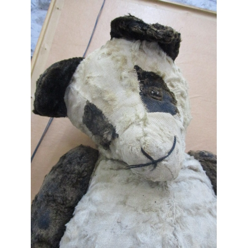 6 - An early, possibly 1950s, Panda Bear in very loved condition, A/F no eyes, leg in need of particular...