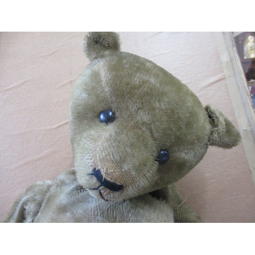7 - 'Alec' - an early English Teddy Bear with boot button eyes and short blonde mohair, in need of refur...