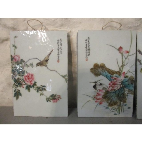104 - A set of four early 20th century Chinese porcelain panels, each decorated with birds and flowers wit...
