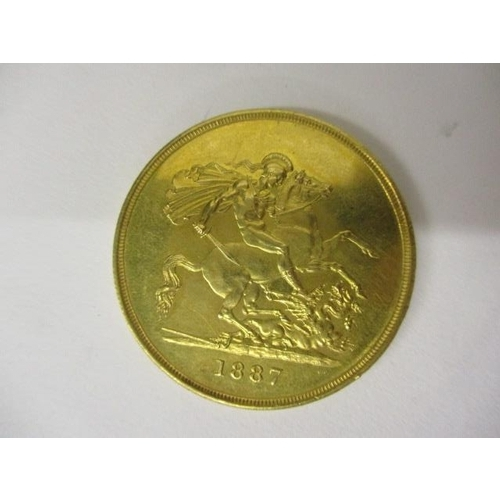 230 - A Victorian £5 gold sovereign with St George to the obverse 1887, 40g...