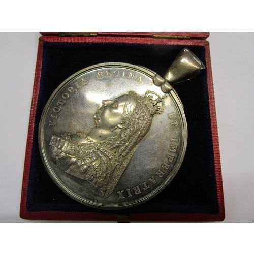 138 - A large 1887 Queen Victoria Jubilee silver medal, official issue, obverse with throned figure repres...