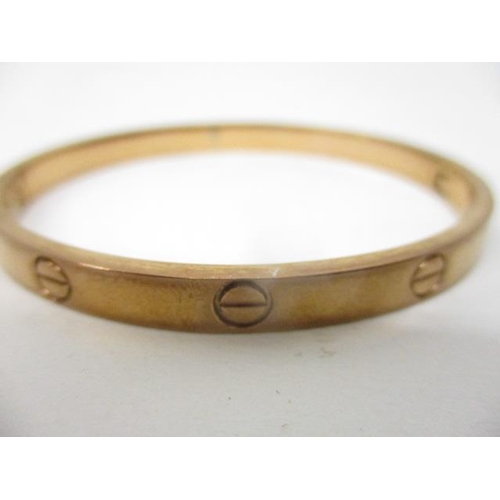 229 - A Cartier 18ct pink gold Love Bracelet, size 16, serial number OL 3688 with screw ornament, 17.2g...