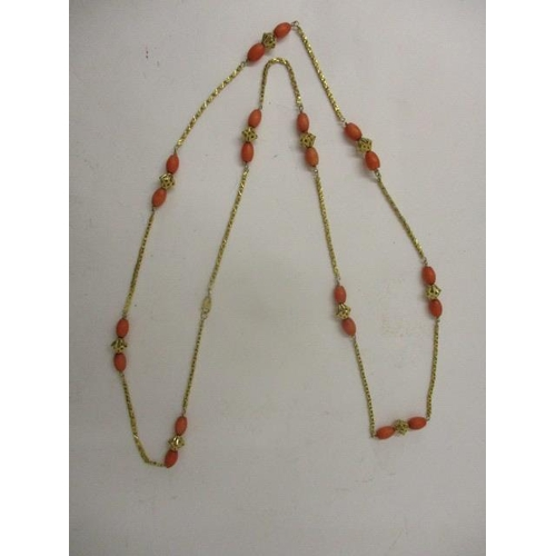 230 - A 22ct gold fancy box link necklace with twenty coral beads and ten pierced gold beads, 37
