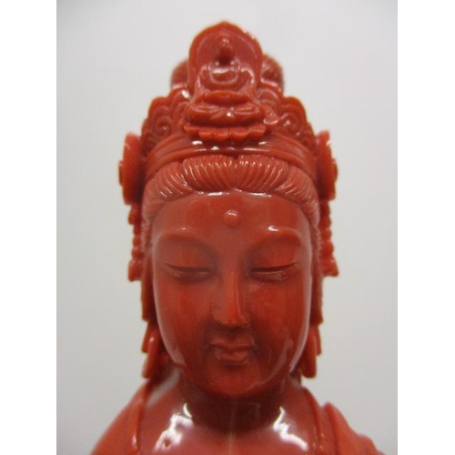 102 - A 20th century Chinese carved, red coloured coral figure of a Goddess standing on a branch, by a bir...