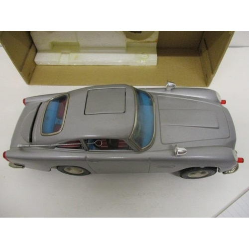 14 - An ASC Aston-Martin Mystery Action toy car, battery operated, 11