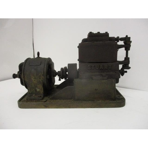 15 - A Stuart model of a direct-coupled, compound vertical steam engine and on electric generator, stampe...