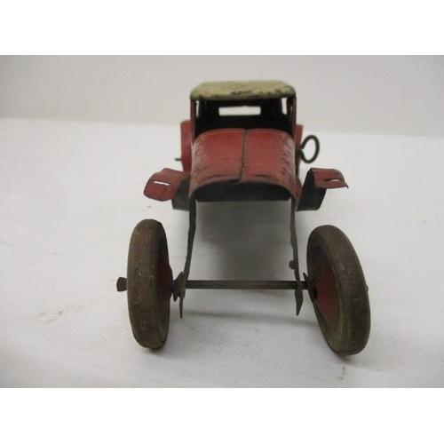 25 - A Burnett tinplate, clockwork saloon car, in red and white, A/F