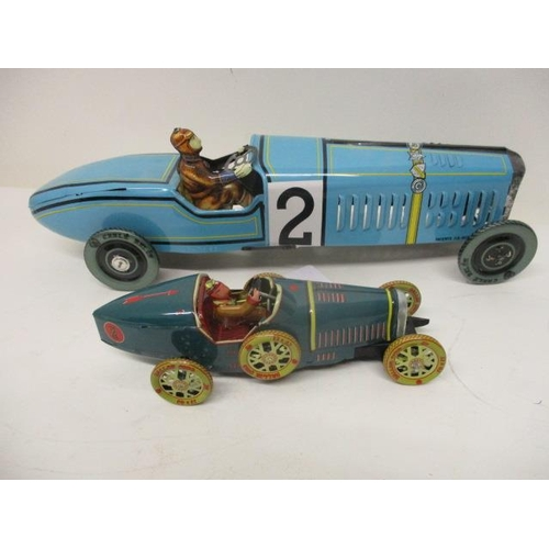 27 - Two reproduction painted, pressed metal clockwork toy racing cars, 7