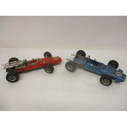 45 - Two Schuco clockwork toy racing cars, a Ferrari Formula 2 no 1073 and a Matra Ford Formula 1 no 1074
