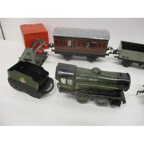 47 - Hornby and Meccano 0 gauge, tin plate model railway related items to include two locomotives and ten...
