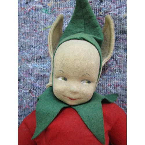 58 - Circa 1950 a Chad Valley cloth doll  in the form of an Imp, with moulded felt head and painted featu...