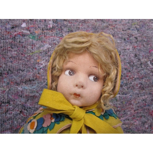 59 - Circa 1930 a Lenci cloth doll with moulded felt head and painted features, moulded felt limbs, dress...