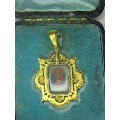239 - A Victorian yellow metal brooch with a glass panel engraved with the initials BS within a lobed, pie...