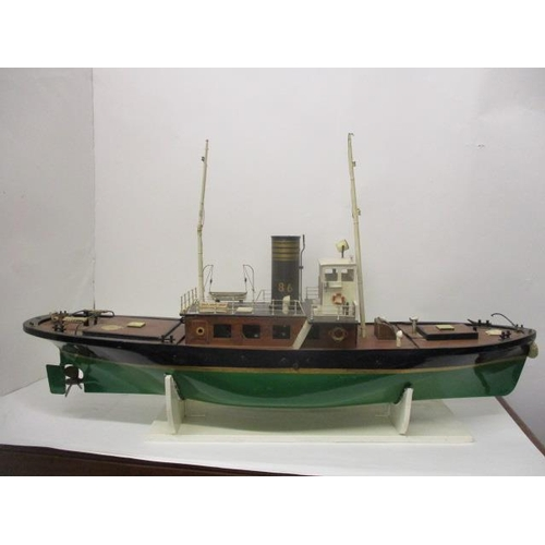 52 - A mid/late 20th century fibreglass, hulled steam driven boat, with a removable plank effect plywood ...