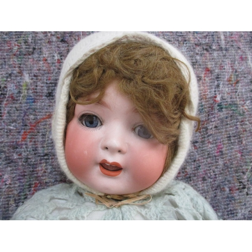 49 - A bisque headed doll marked Heubach Kopplesdorf 321.8 1/2 Germany, with blue glass eyes, with eye la...