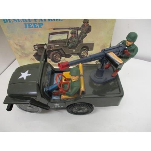 21 - A Japanese JTA Desert Patrol Jeep 3672, battery operated, 11