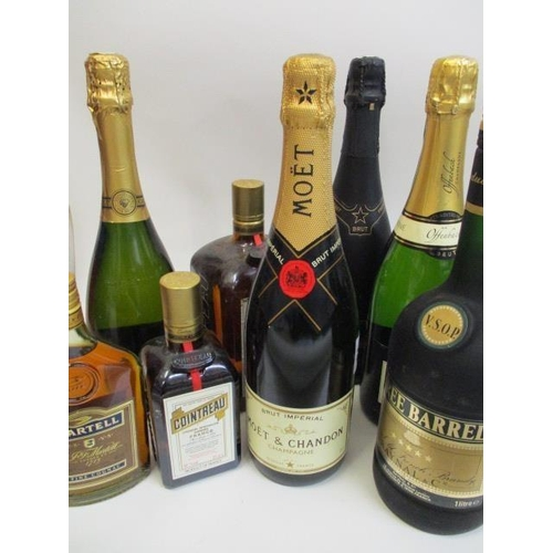 13 - Eight mixed bottles to include Moet et Chandon and Cointreau...