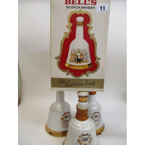 12 - Four Bells Wade Whisky decanters to include one commemorating the birth of Prince William of Wales 2...