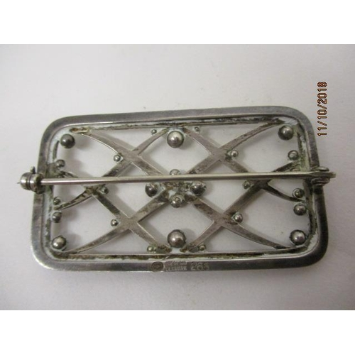 16 - A Georg Jensen silver brooch of rectangular lattice form with ball decoration, stamped 266, 2