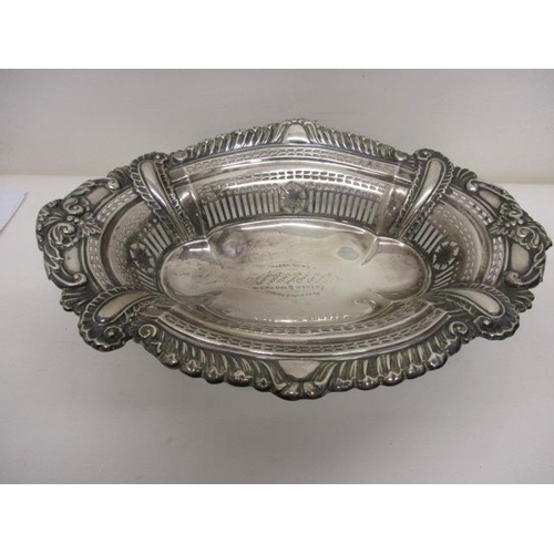 2 - A Victorian silver bread basket by Joseph Gloster, Birmingham 1901, of oval form with embossed and p...