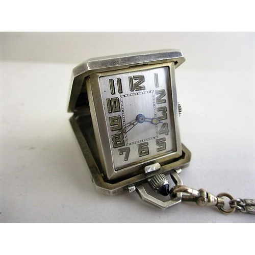 27 - An Edison Watch Company silver travellers pocket watch with an engine turned, spring loaded, snap sh...