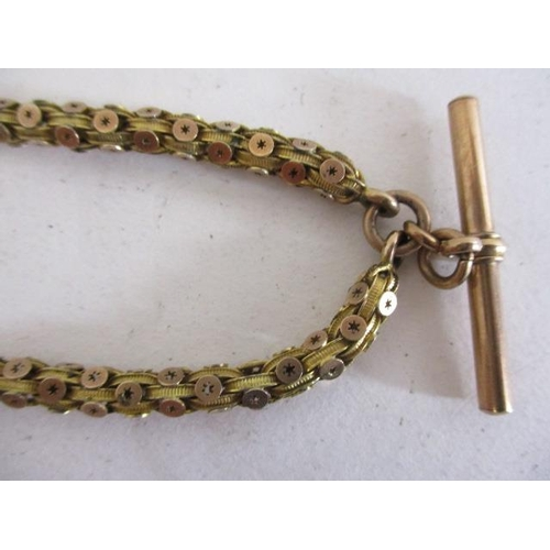 33 - A 9ct gold and yellow metal watch chain with disc and loop links, the T bar and clasp stamped 9ct, 2...