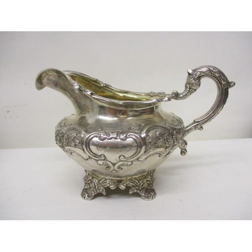 48 - A William IV silver three piece teaset by Leonard Urquhart, Edinburgh 1834 with embossed, chased flo...