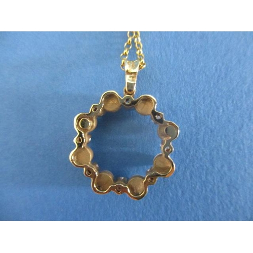 57 - An 18ct gold circular pendant set with eight pearls and eight diamonds, on an 18ct gold chain, 8.8g...