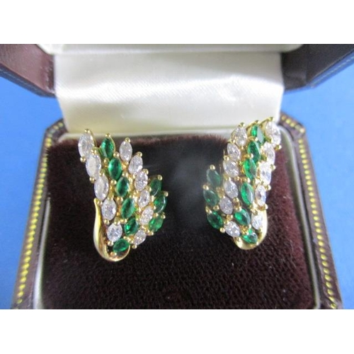 59 - A pair of 18ct gold earrings, each set with four graduated columns of diamonds and emeralds, 9.4g