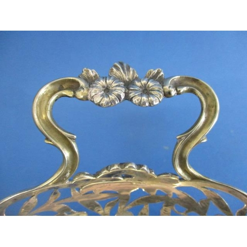 65 - A late 19th century French silver basket with twin, floral handles, pierced, engraved sides with flo...