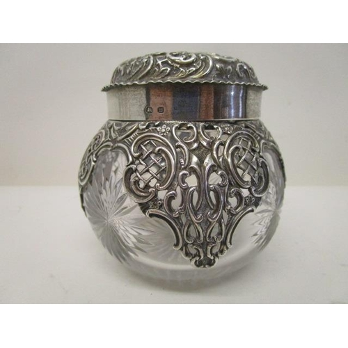 80 - A Victorian clear glass and silver dressing table jar by Henry Matthews, Birmingham 1886 with a dome...