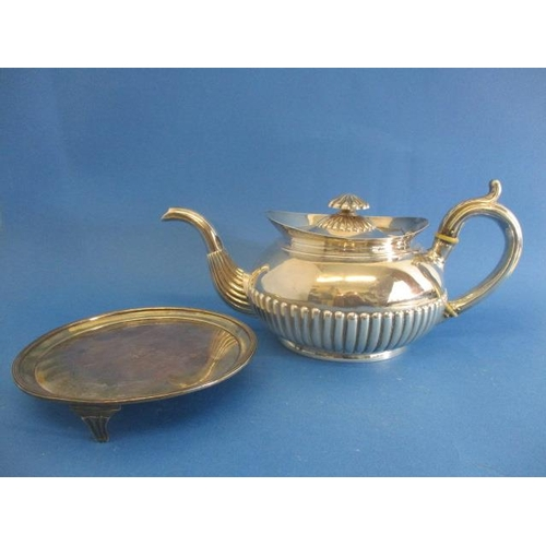 87 - A George III Irish silver teapot and stand by James Scott, Dublin 1804, the teapot with a flared lip...