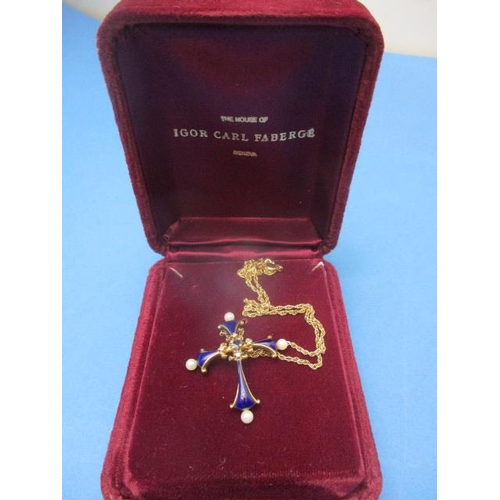 54 - An Igor Carl Faberge, 14ct gold, The Midnight Sapphire Cross, set with a sapphire, four diamonds and...