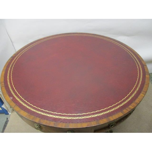 265 - A Regency ebony string inlaid mahogany drum table with a rotating top, a red faux leather scriber ov...