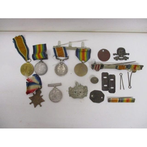 179 - WWI medals, badges and related items to include a Victory and a British war inscribed 27482 PTE F W ...