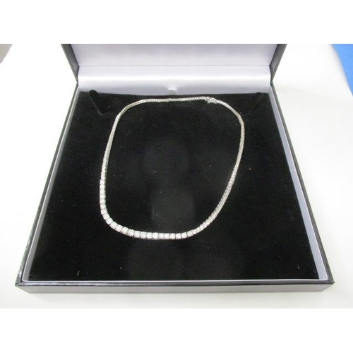 326 - An 18ct white gold necklace set with graduated diamonds, approximately 10ct in total...