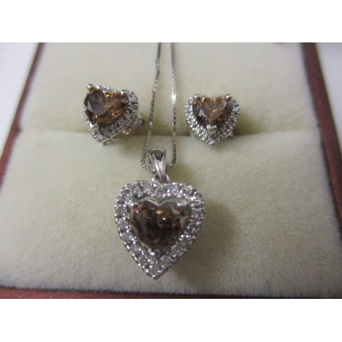 341 - A white gold coloured metal pendant set with a heart shaped Champagne coloured diamond approximately...