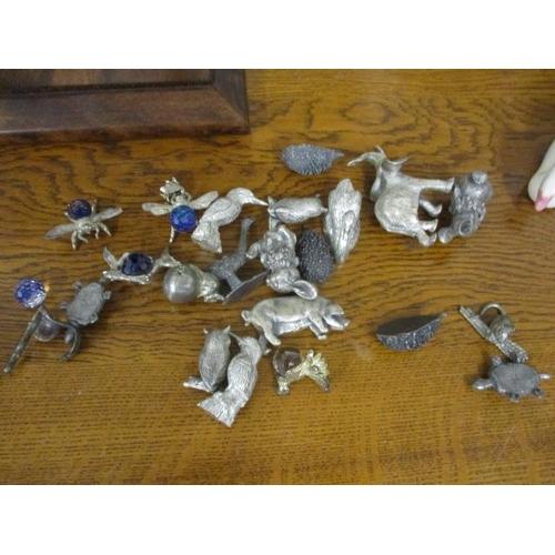 27 - Interior decorative items to include metal model animals, model swans, flower vases, cast iron napki...