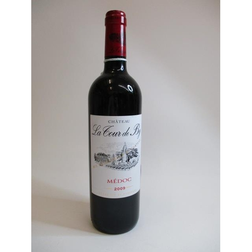 1 - A bottle of Chateau La Tour de by Medoc, 75cl...