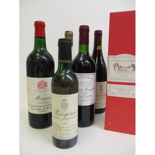 107 - Seven mixed bottles to include a 1985 Bergerac half bottle and a Fortnum and Mason Margaux...