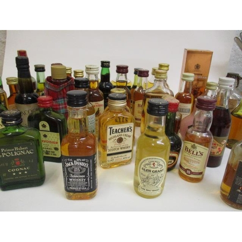 14 - A collection of forty mixed miniatures to include Scotch Whisky and brandy...