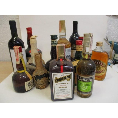 21 - Thirteen mixed bottles to include Southern Comfort and Chartreuse...