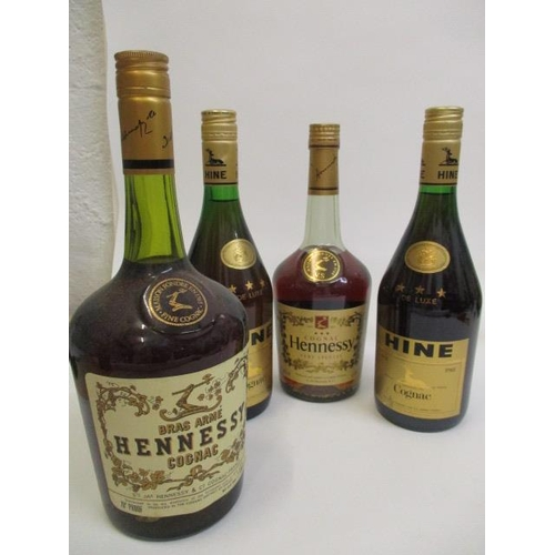 23 - Four bottles of Cognac to include Hennessy and Hine, 2 x 24fl oz, a 68 cl and two pints...