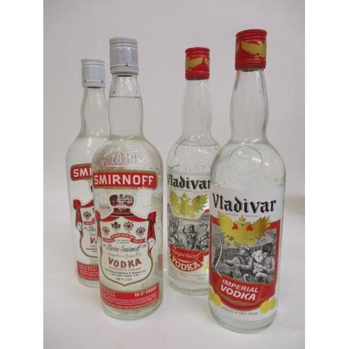 26 - Four bottles of Vodka, Smirnoff and Valdiva, 26fl oz and 24fl oz...